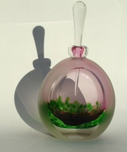Faceted ruby green inland bottle