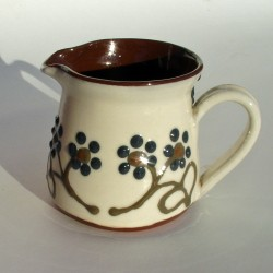Dark flowered cream jug