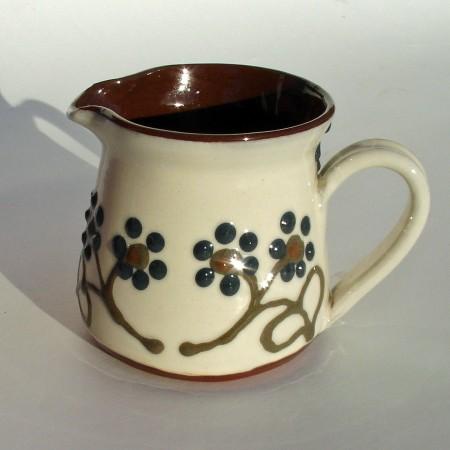 Dark flowered cream jug